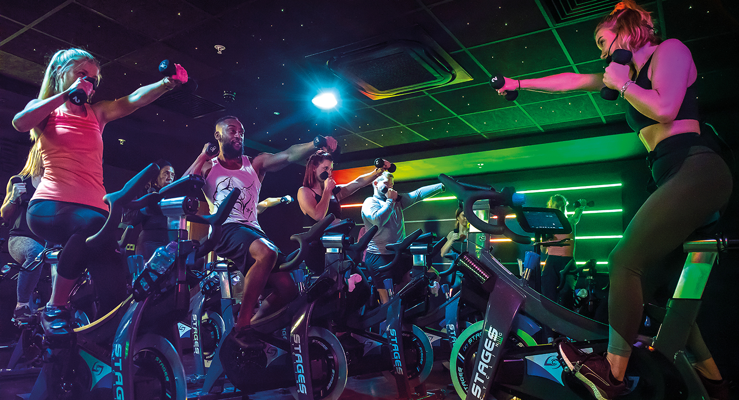 A group of people working out on exercise bikes as part of a Rhythm class at David Lloyd.