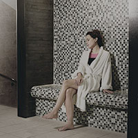 A woman sat relaxing on a bench in the Amida Spa.