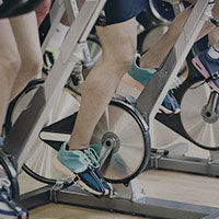 A group of people cycling during a spin class at Harbour Club.