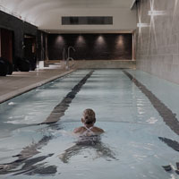 Image of woman swimming in lap pool at Harbour Club Chelsea