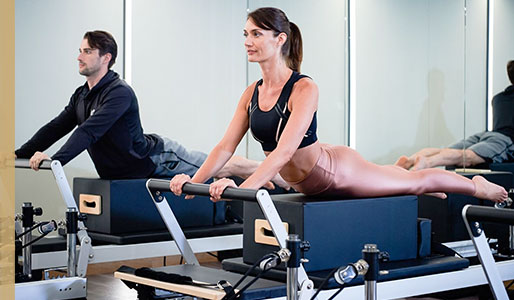 2 people using Reformer Pilates benches at Harbour Club