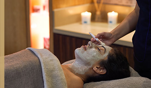 Image of woman having a facial treatment in the spa at Harbour Club Chelsea