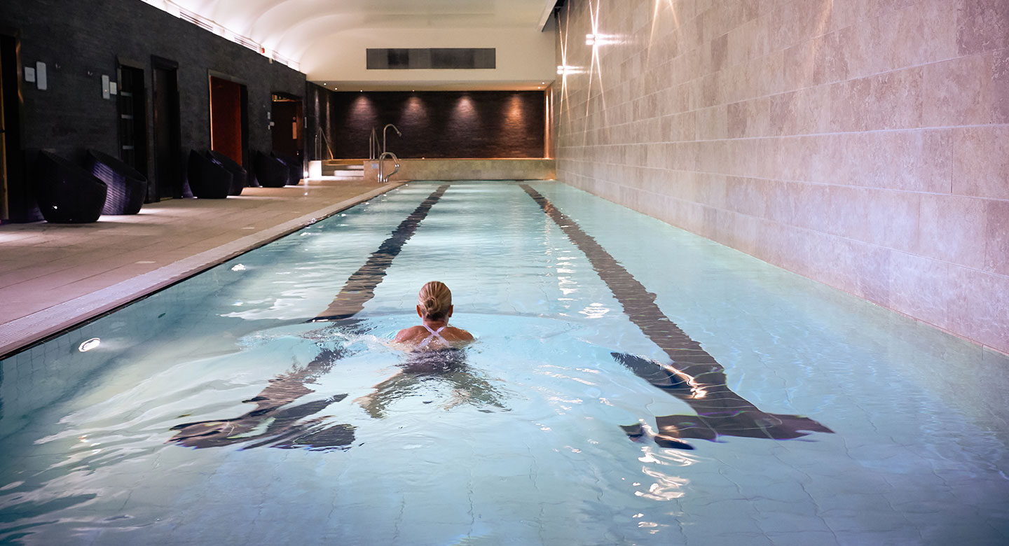Image of woman swimming in the lap pool at Harbour Club Chelsea
