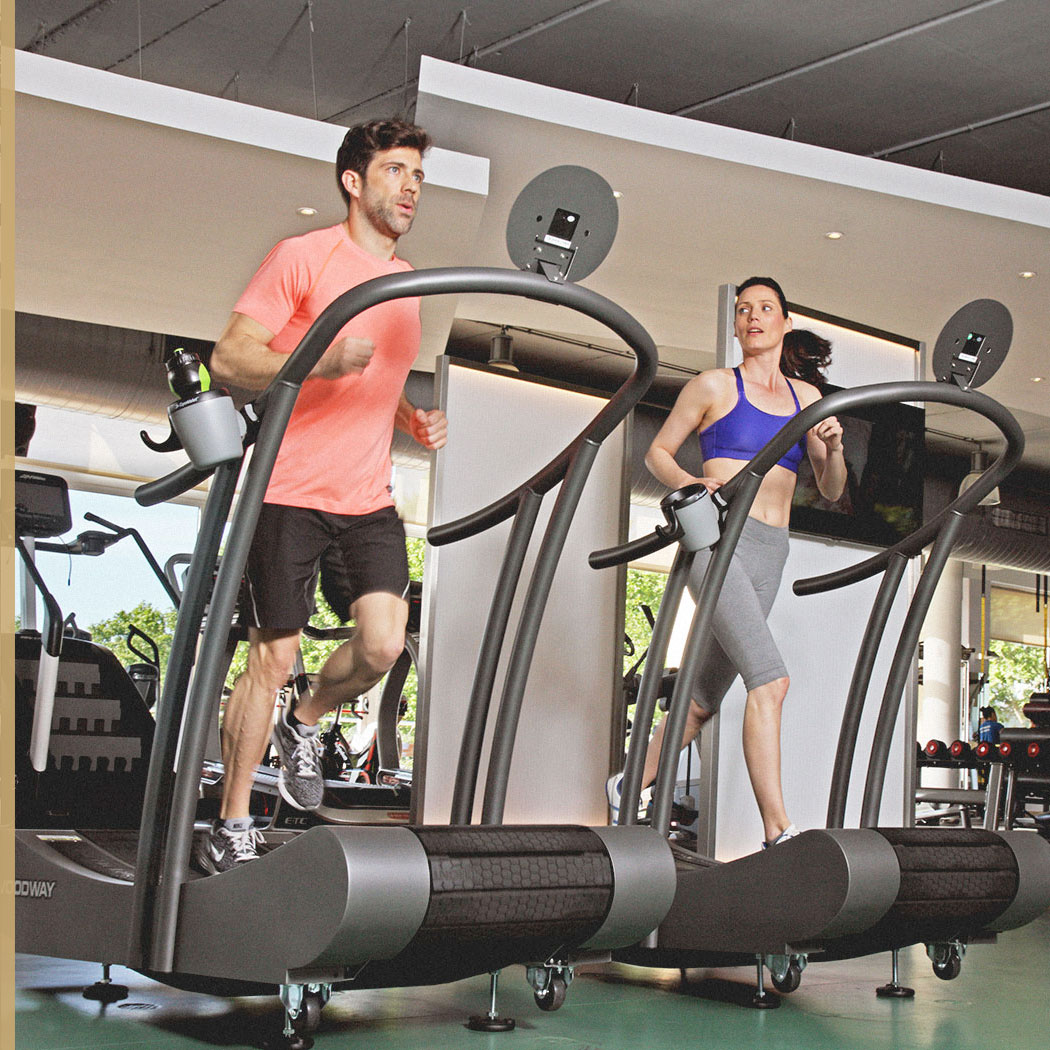 2 people using the Woodway Curve machines at Harbour Club
