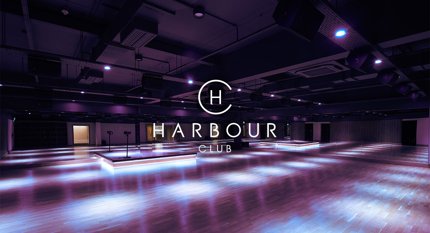 An empty exercise studio with the logo Harbour Club across the top