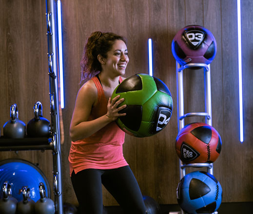 Image woman in gym with medicine ball at Harbour Club Chelsea