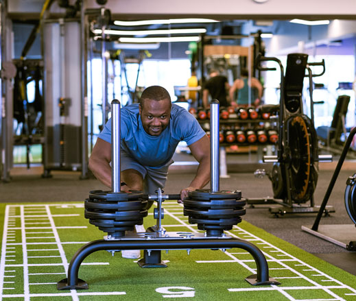 Image of man pushing sled in gym at Harbour Club Chelsea